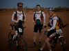 Simpson Desert Bike Challenge, 2007DAY 1: At the Start Line, Purni Bore. Ignorance is Bliss - the Axxis Team in the early morning light. The morning stage of each day started at 6AM