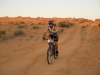 Simpson Desert Bike Challenge, 2007 DAY 1 STAGE 2 and RIDER 18 Ron Whitehead costs downhill