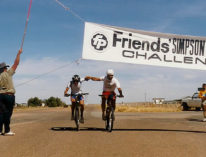 Leon Fisher and Phil McDonald breast the finish line in Birdsville