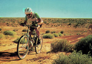 The winner of the Friends Provident Simpson Desert Cycle Challenge, Peter Hansen of Canberra, puts on pace as he crests one of the many low sand ridges that crossed the route